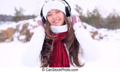 Winter Girl. Dancing with headphone