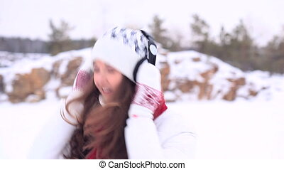 Winter Girl. Dancing with headphone