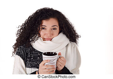 Winter girl drinking coffee to warm up.