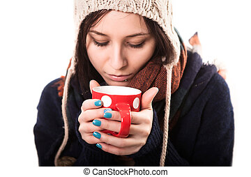 Winter girl drinking tea or coffee to wake up. Lifestyle studio photo isolated portrait of a woman on a white background.