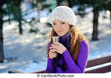 Winter girl drinking