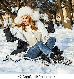 Winter girl in fur coat outdoor