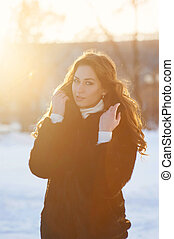 winter girl in the rays
