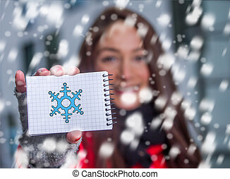 winter girl in the snow with a snowflake on a sheet