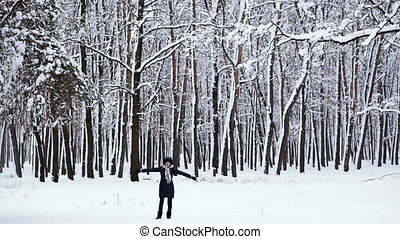 Winter. Girl in the snowy forest
