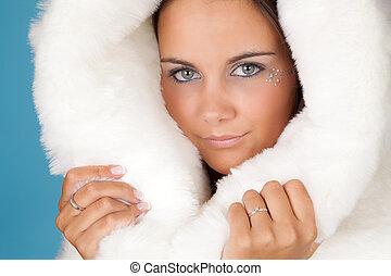 Winter girl in white fur