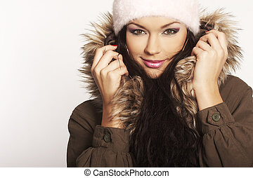Winter Girl - beautiful brunette with hat posing on white...