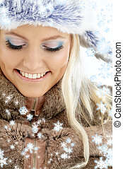 portrait of lovely beauty in winter clothes with snowflakes