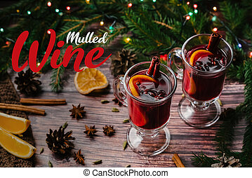 hot drink mulled wine in glasses with Christmas decor on a wooden table