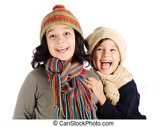 Winter happiness, two children, boy and girl smiling