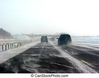 Winter highway during snow storm, poor visibility