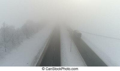 Winter highway in the fog. Aerial video