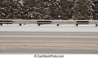 Winter highway. Snow, blizzard, car