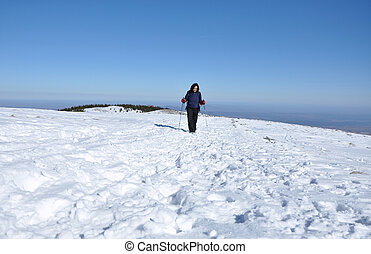 Winter hiking woman in the snow