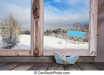 Winter holiday traveller concept: Wooden window sill with...