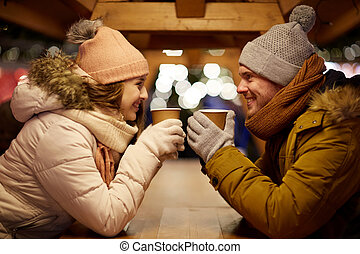 happy young couple with coffee at christmas market - winter ...