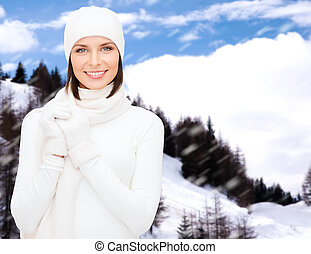 woman in hat, muffler and gloves - winter holidays,...