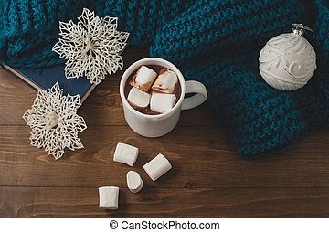 winter home background - cup of hot cocoa Christmas ball and snowflakes