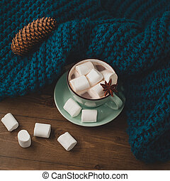winter home background - cup of hot cocoa with marshmallow