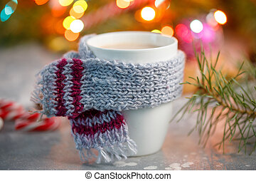 Winter hot drink christmas background. Holiday cocoa cup lollipops on a table. Xmas beverages concept. New year cocoa advertisement design.