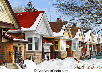 Winter houses - Row of residential houses in winter with ...