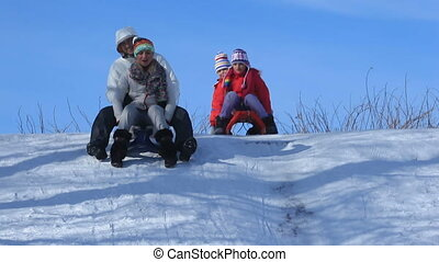 Winter ice-run - Happy couple riding sledges, their kids...