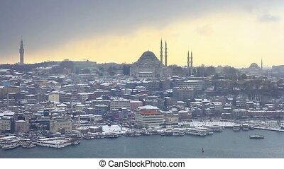 Winter in Istanbul. In the distance Suleymaniye Mosque in snow