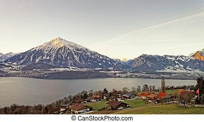 Winter in Swiss Alps peaks near the Thun lake