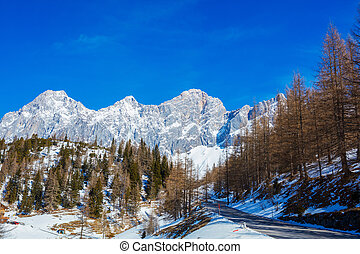 Winter in the austrian alps. Road in mountains