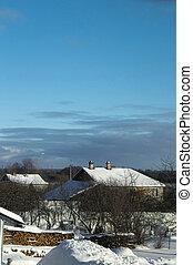 Winter in village on turn blue background