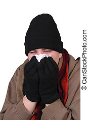 Winter influenza - Teenage male blowing his nose into a...