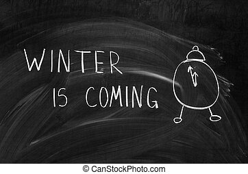 winter is coming handwritten on a chalkboard with chalk