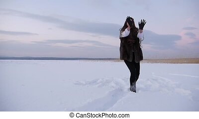 Winter Joyful Girl Catchin Snowballs.