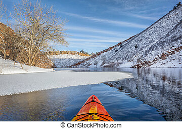 winter kayak paddling in Colorado - winter kayak paddling on...