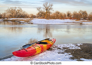 winter kayaking in Colorado - red whitewater kayak on shore ...