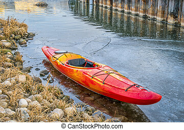 winter kayaking in Colorado - red whitewater kayak with on ...