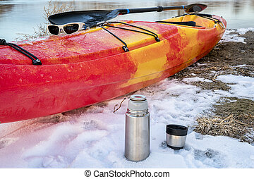 winter kayaking in Colorado - thermos bottle with hot tea ...