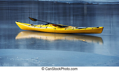 winter kayaking in ukraine - lonely yellow kayak on the ...