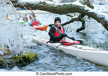winter kayaking on the river in Ukraine 02 - man kayaking on...