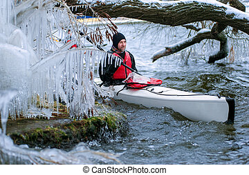 winter kayaking on the river in Ukraine 03 - man kayaking on...