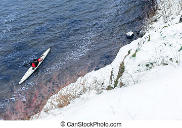 winter kayaking on the river in Ukraine 23 - man paddles a ...