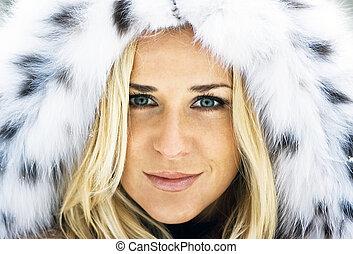 Winter lady - Blond girl wearing white fur coat in winter