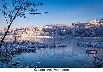 Winter lake at sunrise