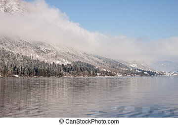 winter lake landscape with reflactions