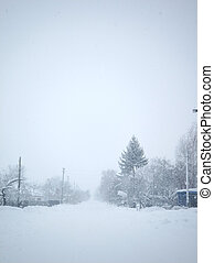 Winter landscape. A distant village in the cold part of the planet. White snow covered road