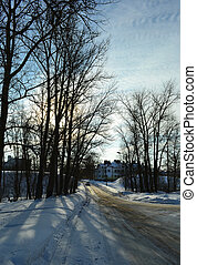 Winter landscape and road at sunset