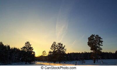 Winter landscape at sunset. Time Lapse. 4K