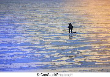 winter landscape fisherman on the river