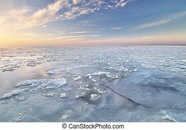 Winter landscape. Ice on water.