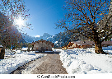 Winter landscape in a mountain valley with huts. Tyrol, Austria.